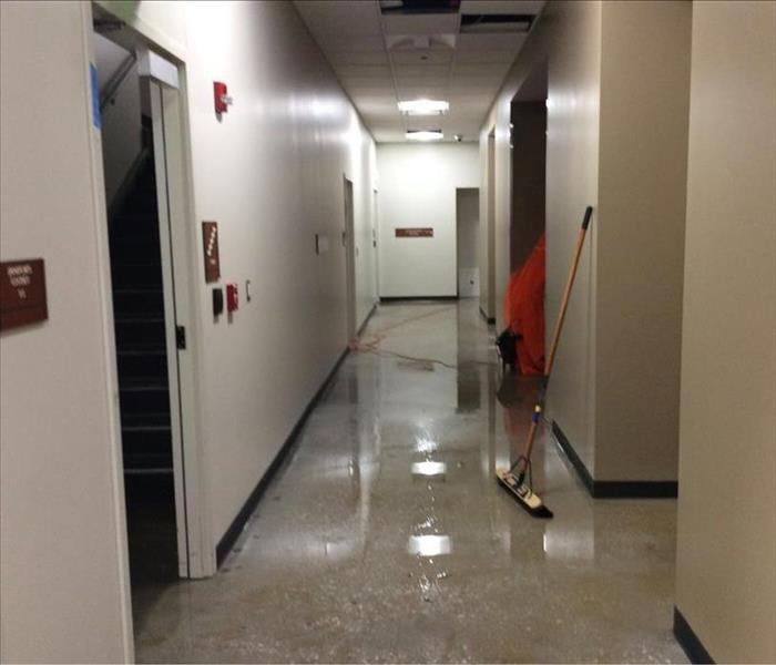 Standing water in commercial hallway.