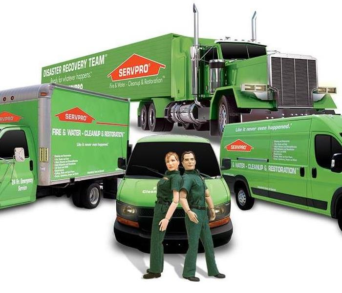 Here to help - image of SERVPRO vehicles and Stormy and Blaze